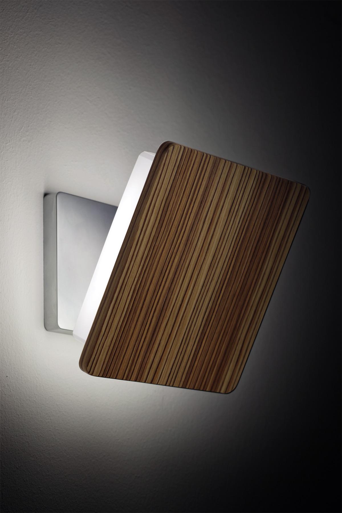 Neobična i elegantna zidna lampa s fotografija deo je kolekcije f06 nomore koju proizvodi fabbian baza od livenog aluminijuma može imati mat hromiranu